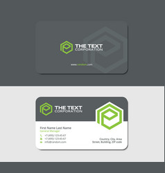 Gray business card with green hexagon letter e vector