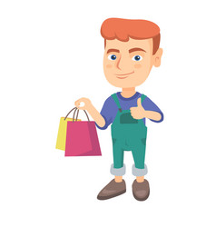 happy caucasian boy holding shopping bags vector image