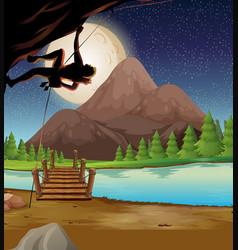 man climbing rock on fullmoon night vector image