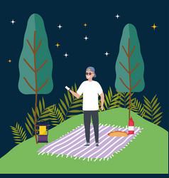 Man using smartphone night lantern trees meadow vector
