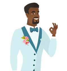 Young african-american groom showing ok sign vector