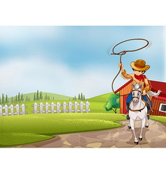A cowboy holding a rope riding on a horse vector image