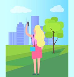 Woman taking selfie in city park vector