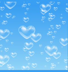 Heart shaped bubbles in water on blue background vector