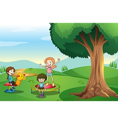 Kids playing above hills vector