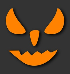 Scary face of Halloween pumpkin on black vector