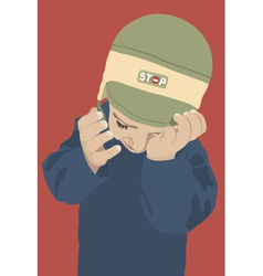 crying kid with green cap on red background vector image