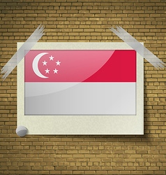Flags Singaporeat frame on a brick background vector image