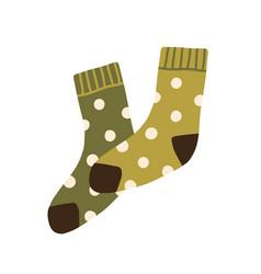Pair warm wool socks with polka dot pattern vector