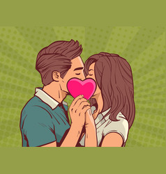Young couple kissing hollding pink heart man vector