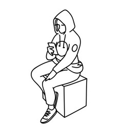 Young woman in hoodie sitting on box looking at vector