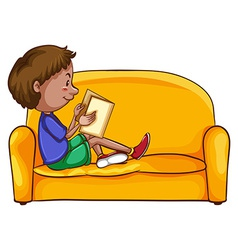 A boy reading while sitting down vector image