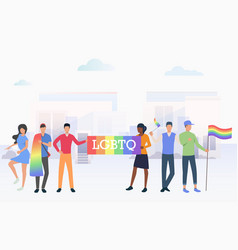 People holding lgbtq flags in pride parade in city vector