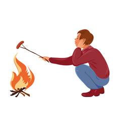 brown-haired camper boy in sweater roasting vector image