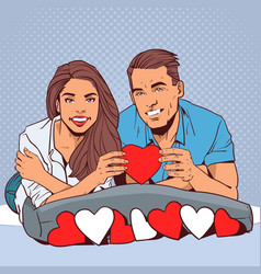 happy couple holding red heart smiling man and vector image