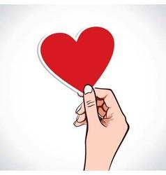 Heart shape sticker in hand vector
