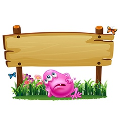 A tired monster under the empty signboard vector image
