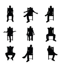 man silhouette sitting on chair set in black color vector image