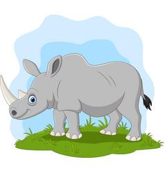 cartoon happy rhino on grass vector image