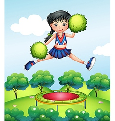 A cheerleader jumping with her green pompoms above vector