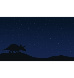 Silhouette of triceratops at night landscape vector