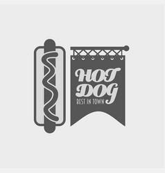 hot dog in a badge label or logo concept poster vector image