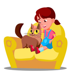 little girl with a cat sitting on the sofa vector image