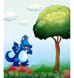 A blue dragon at the forest standing above the vector