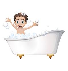A little boy at the bathtub vector image