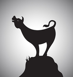 cow standing on rocks vector image