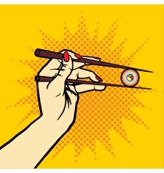Hand with chopsticks and sushi pop art vector