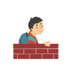 Teen boy with backpack standing behind brick wall vector
