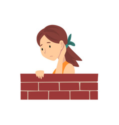 Girl standing behind brick wall cartoon vector