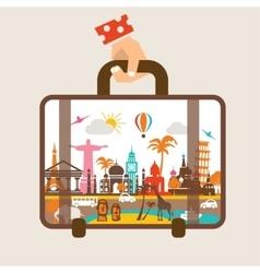 hand holding luggage travel around the world vector image