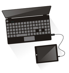 laptop connected to tablet top view vector image