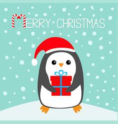 Merry christmas candy cane penguin on snowdrift vector