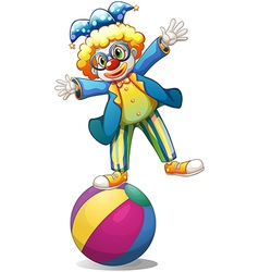 A playful male clown at the top of a ball vector image vector image