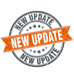 New update round grunge ribbon stamp vector