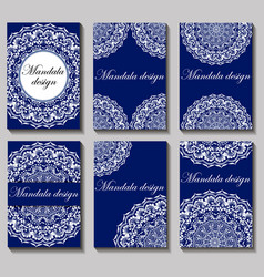 set mandala designs on a blue background vector image