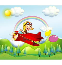 A monkey riding on a red plane with two balloons vector image vector image