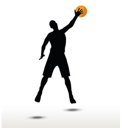 basketball player slhouette in slam pose vector image