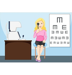 Woman having her eyes checked vector