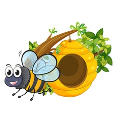 A smiling bee beside the beehive vector image vector image