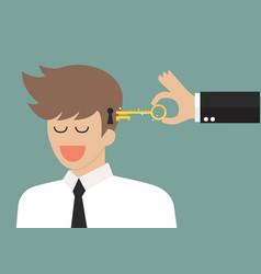 man holding a key unlocking businessman mind vector image vector image