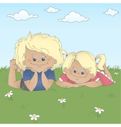 Children lying on a grass vector image