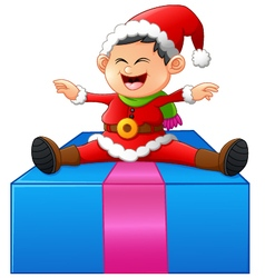 little santa sitting on gift box vector image