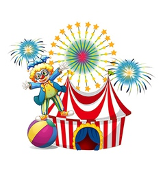 A male clown playing outside the tent vector image