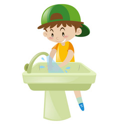 Boy washing hands in sink vector
