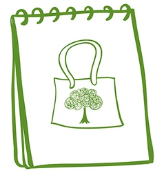 A green notebook with a bag at the cover page vector image