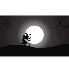 Silhouette of witch and full moon vector